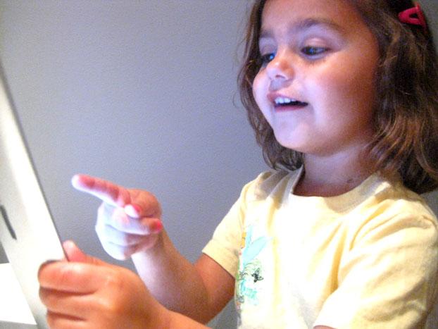 kid playing with iPad