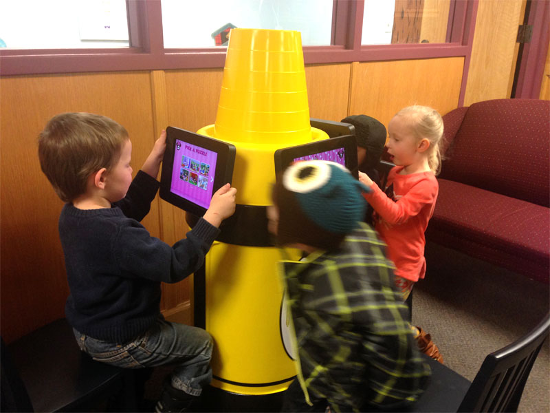 kids in day care playing with Krayon kiosk iPad Stand